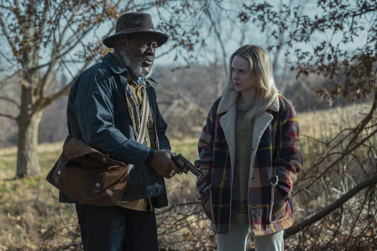 FRANKIE FAISON and RACHEL BROSNAHAN star in I'M YOUR WOMAN and hold a gun in a scene