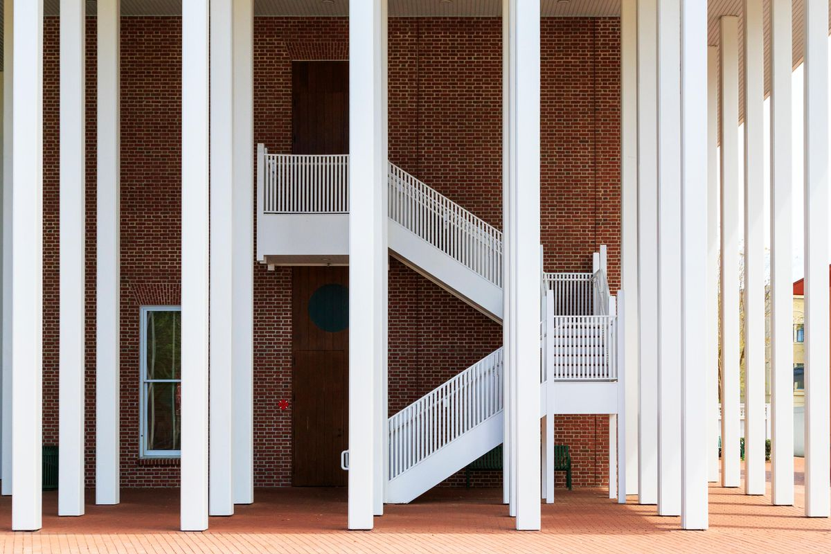 The town hall in the town of Celebration, Florida, a building with white columns and an exterior white staircase