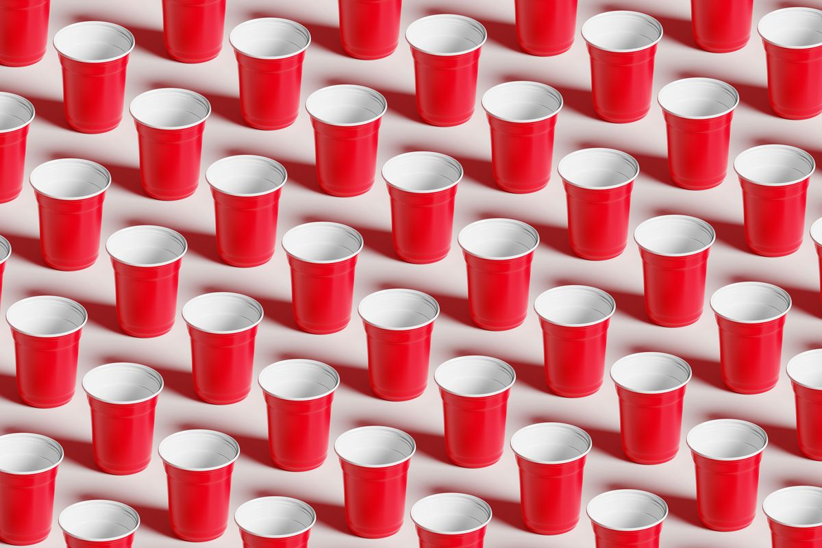 Red plastic cups laid out in lines.