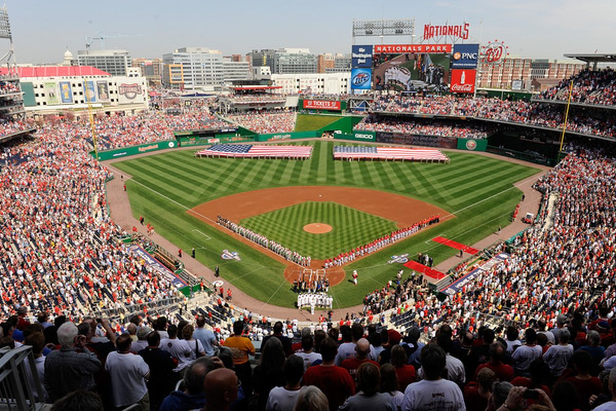 WASHINGTON - APRIL 05:  The Philadelphia Phillies and the Washington Nationals line up for the national anthem on Opening Day at Nationals Park on April 5, 2010 in Washington, DC.  (Photo by Greg Fiume/Getty Images)