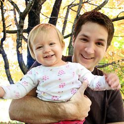 "John Jones holds his 13-month-old  daughter, Elizabeth ""Lizzie"" Dawn Jones. John Jones died in Nutty Putty Cave Wednesday, Nov. 25, 2009."