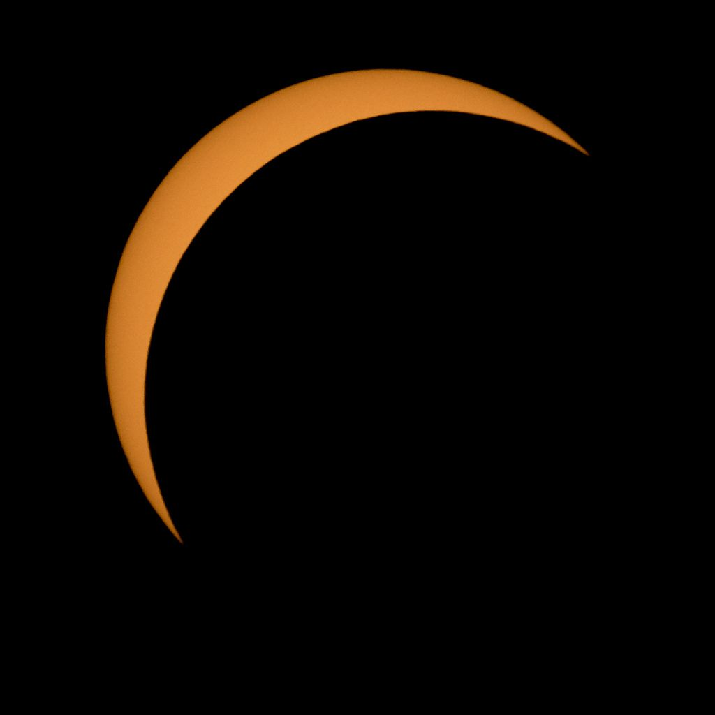 The moon is seen passing in front of the Sun during Monday's solar eclipse in Ross Lake, Northern Cascades National Park, Washington.   Bill Ingalls/NASA via Getty Images