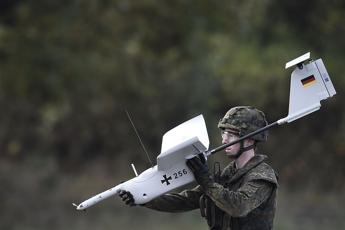 A German soldier holds a military drone during exercises in Germany (Alexander Koerner/Getty Images)