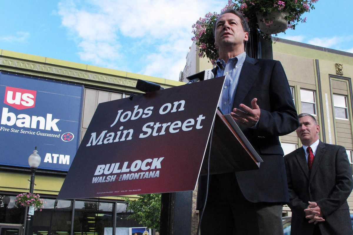 Democratic nominee for governor Steve Bullock, left, outlines his proposal to give Montana homeowners a $100 million property tax rebate if he is elected this fall during a Monday, June 11, 2012, news conference in Helena, Mont. Bullock and running mate J