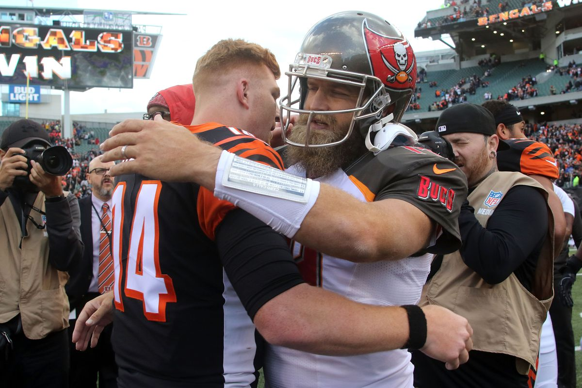 Andy Dalton of the Cincinnati Bengals and Ryan Fitzpatrick of the Tampa Bay Buccaneers congratulate each other at the end of the game at Paul Brown Stadium on October 28, 2018 in Cincinnati,