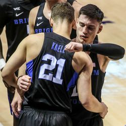 Brigham Young Cougars guard Alex Barcello (13) hugs his teammates and coaches at the one minute mark remaining during a game against the Saint Mary's Gaels in Provo on Saturday, Feb.27, 2021.