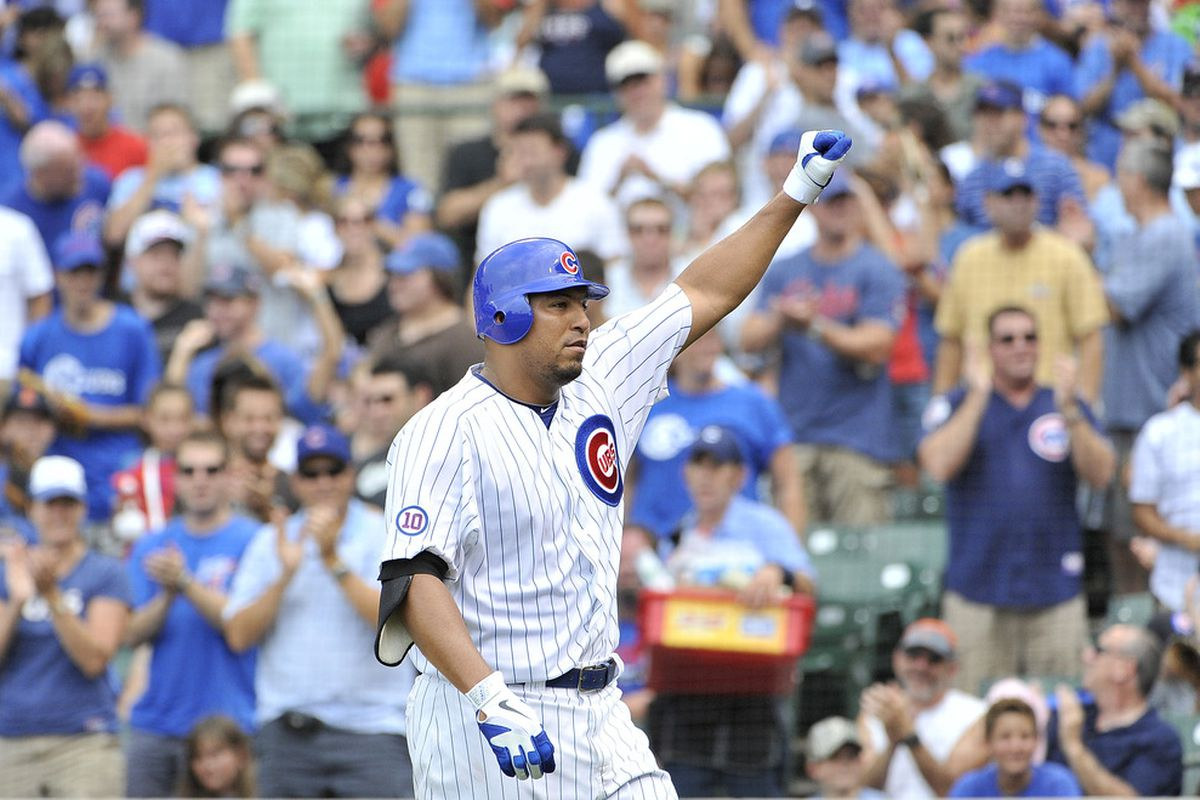 Carlos Zambrano of the Chicago Cubs raises his fist after hitting a solo home run during the third inning against the Cincinnati Reds at Wrigley Field on August 6, 2011 in Chicago, Illinois.  (Photo by Brian Kersey/Getty Images)