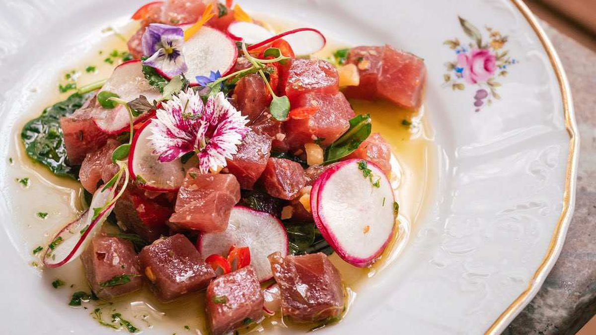 raw fish on white, floral, gold-rimmed plate