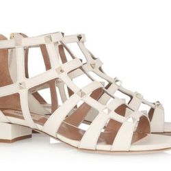 """Net-a-Porter: Valentino Studded leather cage sandals, $895. Available <a href=""""http://www.net-a-porter.com/product/182650#"""">here</a>."""