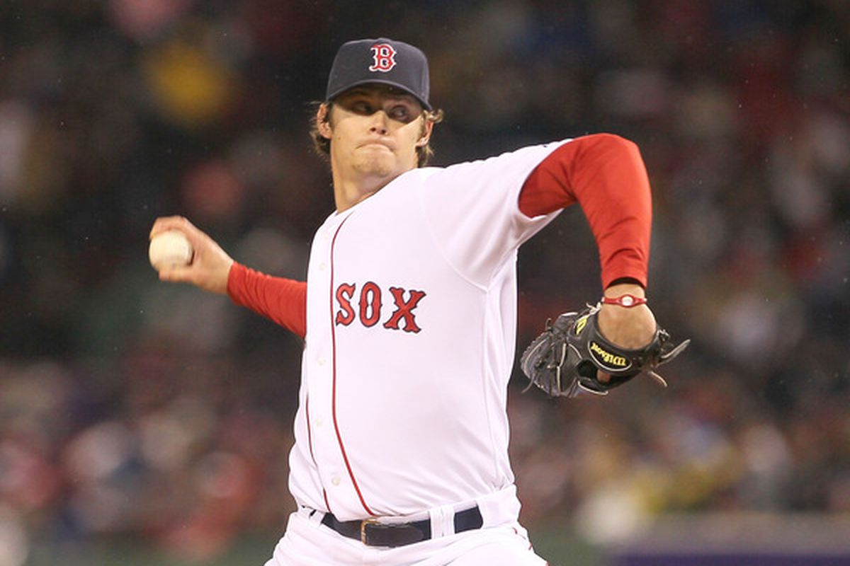 BOSTON - APRIL 17:  Clay Buchholz #11 of the Boston Red Sox throws against the Tampa Bay Rays at Fenway Park on April 17, 2010 in Boston, Massachusetts. (Photo by Jim Rogash/Getty Images)