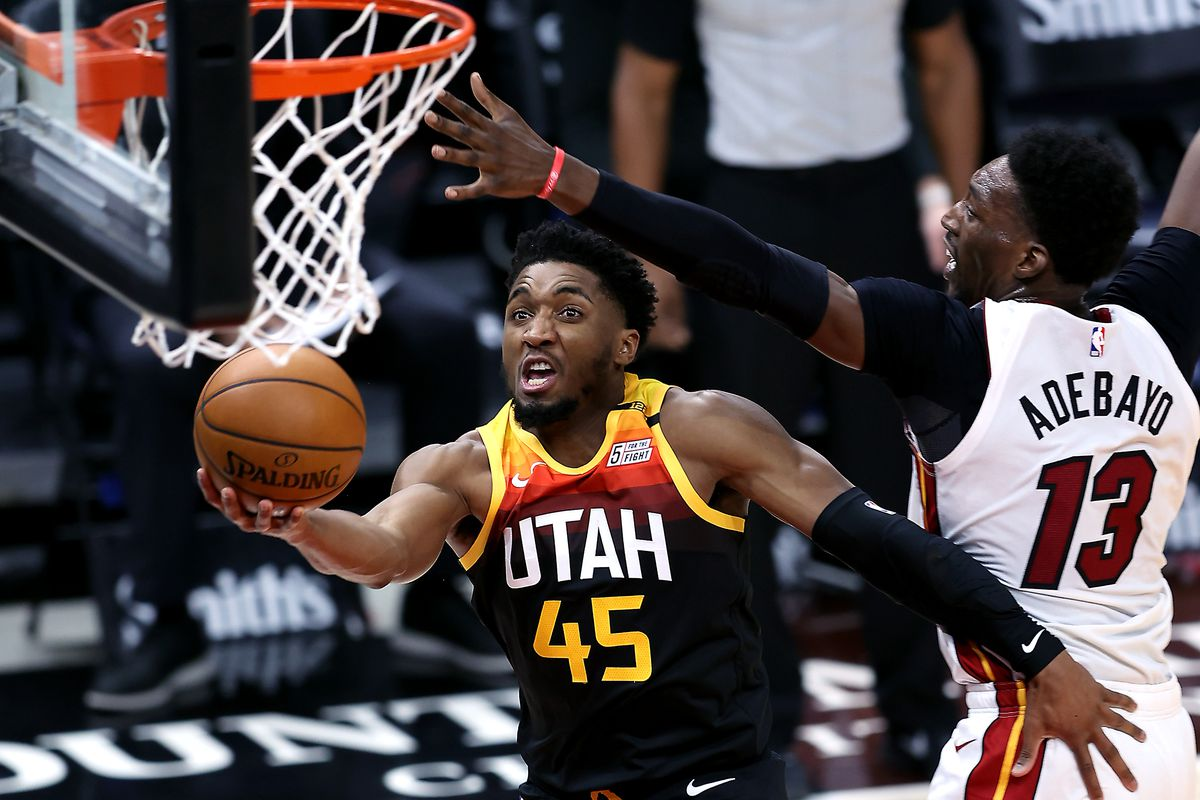 Utah Jazz guard Donovan Mitchell (45) goes around Miami Heat center Bam Adebayo (13) for a lay up as the Utah Jazz and the Miami Heat play an NBA basketball game at Vivint Smart Home Arena in Salt Lake City on Saturday, Feb. 13, 2021.