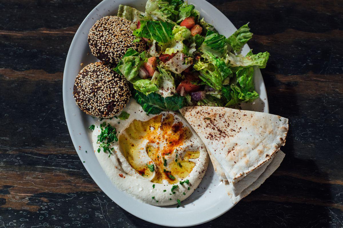 hummus, labneh, falafel, and salaed at Torshi in Politan Row