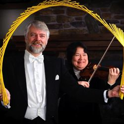 """Richard and Rosemary Hatch performing a Japanese feat known as """"Nankin Tamasudare,"""" which involves twisting a bamboo mat into various shapes. The magic goes with a story Hatch wrote titled """"Taro-San The Fisherman and the Weeping Willow Tree."""""""
