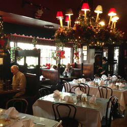 Georgetown's historic Martin's Tavern hangs tons of quaint greenery and ribbons each year.