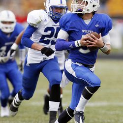 Nick Vigil of Fremont makes a touchdown run while Tyler Ottesen of Bingham gives chase as Bingham High School faces Fremont High School in football played in Plain City, Friday, Nov. 4, 2011.