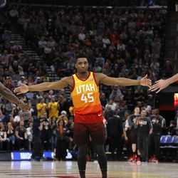 Utah Jazz's Donovan Mitchell (45) celebrates with Jae Crowder (99) and Rudy Gobert (27) after the first half of the team's NBA basketball game against the Minnesota Timberwolves on Friday, March 2, 2018, in Salt Lake City. (AP Photo/Kim Raff)