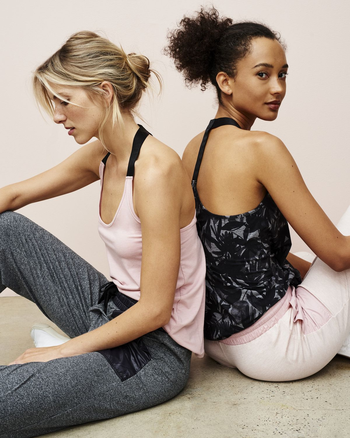 Two models wearing Lou & Grey workout clothes