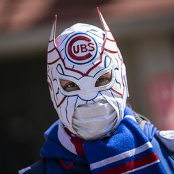 William Gonzalez, 40, of Gage Park, wears a Cubs-themed luchador mask outside Wrigley Field on Opening Day 2021.