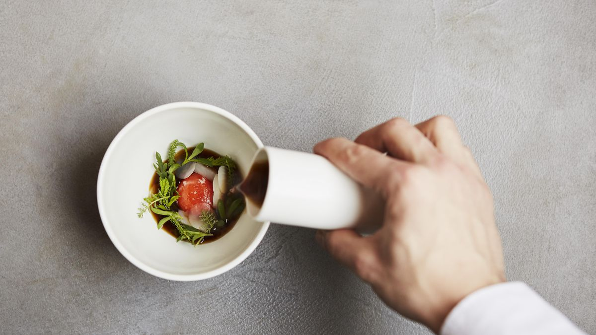 A sauce being poured over a bowl at Roganic in Marylebone