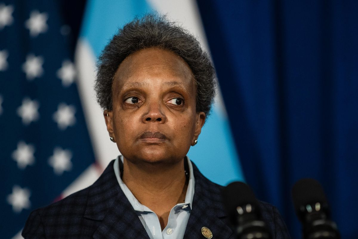 Chicago Mayor Lori Lightfoot listens to a question during a news conference