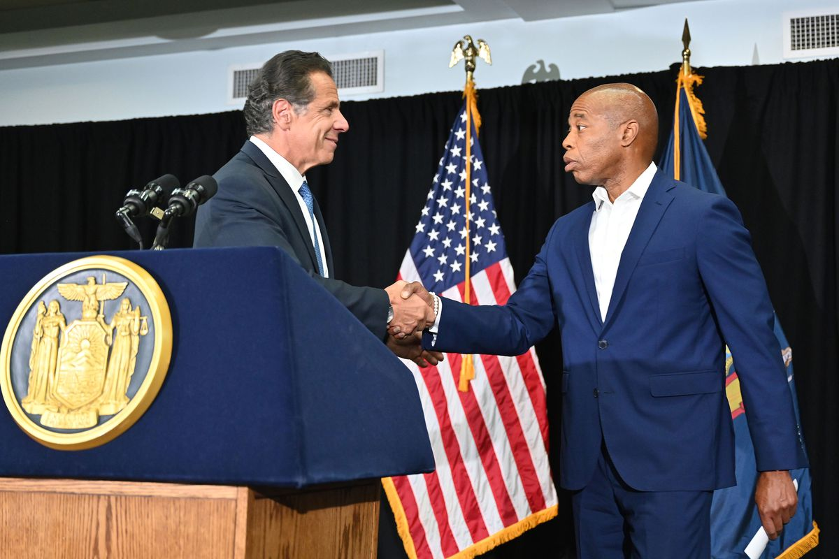 Brooklyn Borough President Eric Adams speaks with Governor Andrew Cuomo at the Lenox Road Baptist Church on Nostrand Avenue, July 14, 2021.