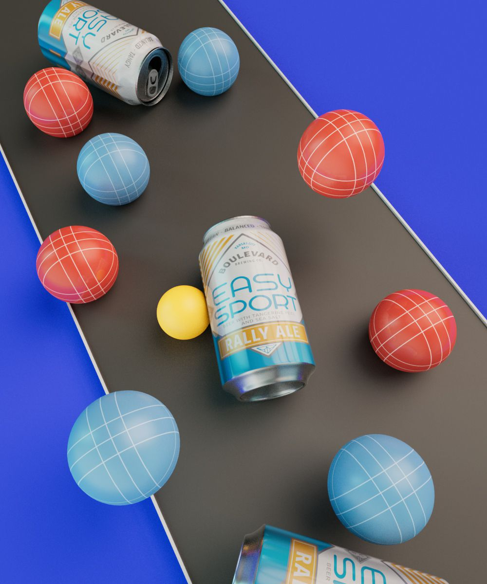 Boulevard Brewing Co.'s Easy Sport Rally Ale staged on the ground with blue and red boccee balls and lawn games.