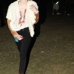 Emma Watson combats chilly desert nights in a fuzzy vintage jacket.
