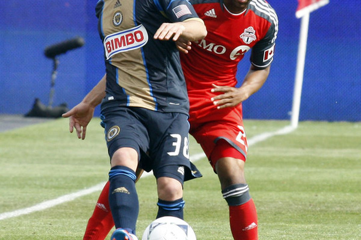 TORONTO, CANADA - MAY 26: Jeremy Hall #25 of Toronto FC battles for the ball with Kai Herdling #38 of the Philadelphia Untion during MLS action at BMO Field May 26, 2012 in Toronto, Ontario, Canada.  (Photo by Abelimages/Getty Images)