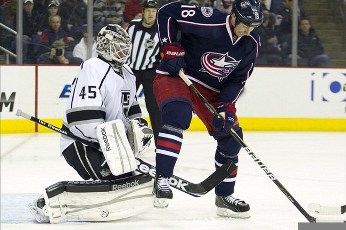 March 8, 2012; Columbus, OH, USA; Columbus Blue Jackets left wing R.J. Umberger (18) tries to redirect the puck past Los Angeles Kings goalie Jonathan Bernier (45) at Nationwide Arena. Mandatory Credit: Greg Bartram-US PRESSWIRE