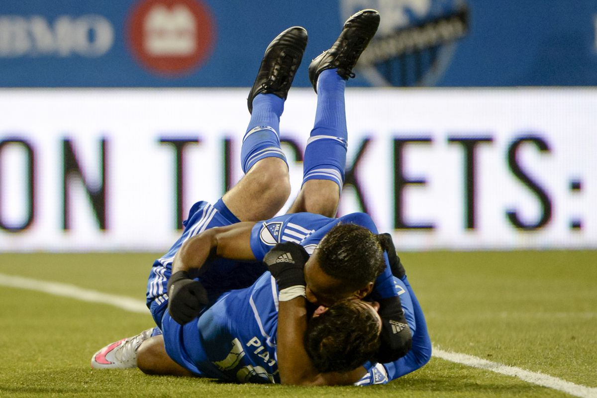 IMFC's two DPs Ignacio Piatti and Didier Drogba celebrate a goal against Toronto FC.