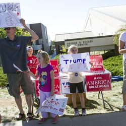 David Wald campaigns with his daughters Tessa and Catherine in support of presidential candidate Donald Trump at a rally before the Utah and BYU rivalry game in Salt Lake City on Saturday, Sept. 10, 2016.