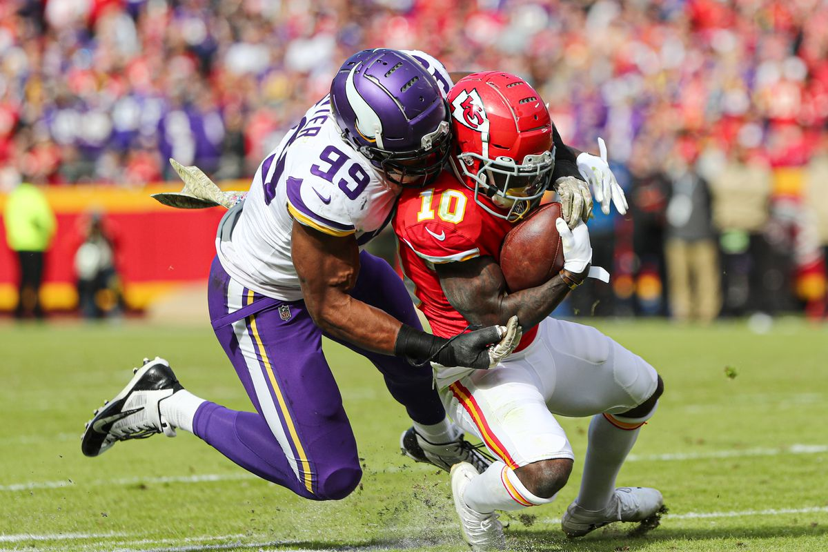 Kansas City Chiefs wide receiver Tyreek Hill is tackled by Minnesota Vikings defensive end Danielle Hunter during the first half at Arrowhead Stadium.