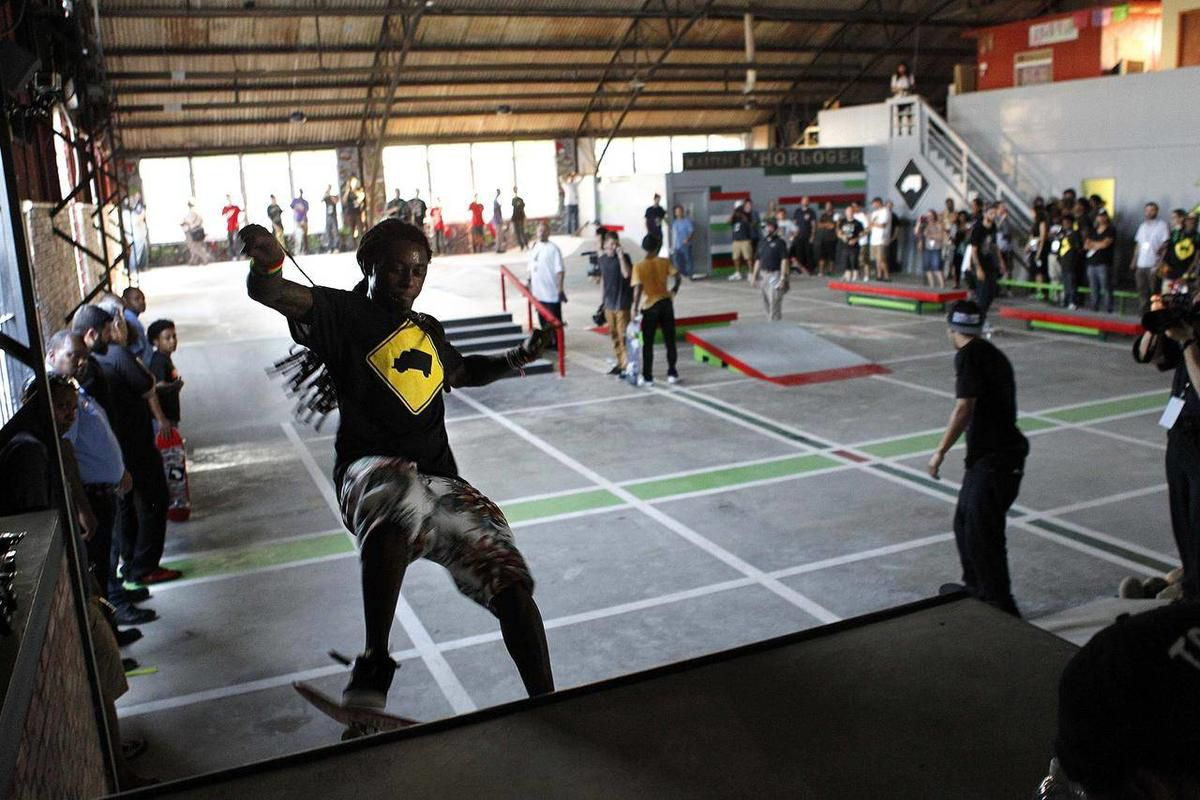 Recording artist Lil Wayne skates in a new skateboard park he helped finance along with Glu Agency and Mountain Dew, in the Lower Ninth Ward of New Orleans, Wednesday, Sept. 26, 2012.