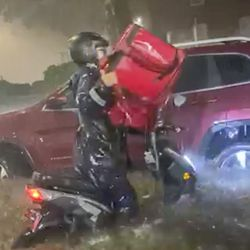 Delivery workers in Astoria toiled in waist-deep water for less than minimum wage as the remnants of Hurricane Ida poured over the region on Sept. 1, 2021.