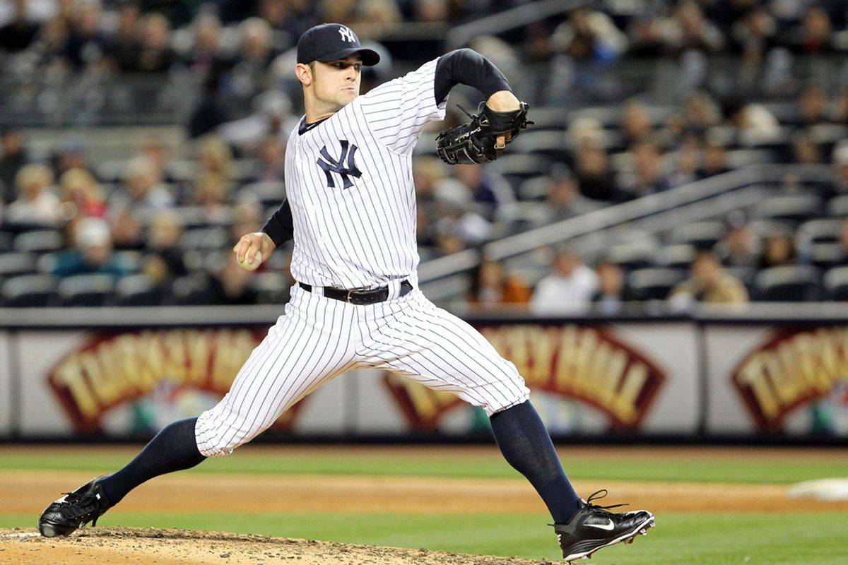 Apr 30, 2012; Bronx, NY, USA;   New York Yankees relief pitcher David Robertson (30) pitches during the eighth inning against the Baltimore Orioles at Yankee Stadium.  Yankees won 2-1.  Mandatory Credit: Anthony Gruppuso-US PRESSWIRE