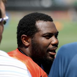 Broncos RB C.J. Anderson takes a minute to talk with the press after the final training camp pracitce.