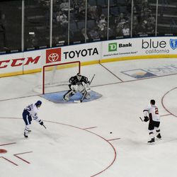 Cal Petersen prepares to stop a shot in the pass and score challenge