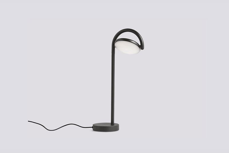 Small lamp with black base and frame.