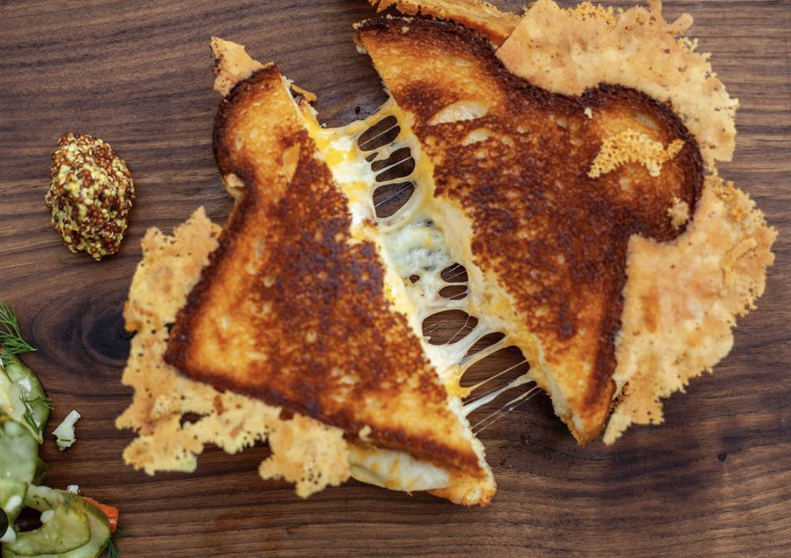 A grilled cheese sandwich with lots of cheese.