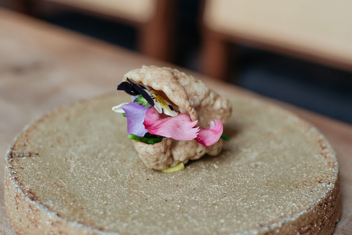 Puffed cow skin sandwich with pistachio emulsion and pickled flowers at Michelin-starred Ikoyi restaurant, London