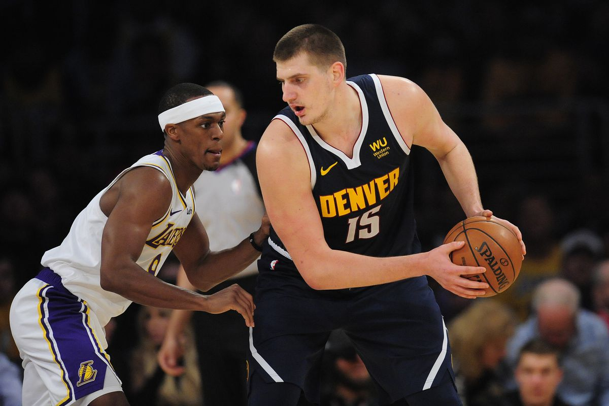 Denver Nuggets center Nikola Jokic controls the ball against Los Angeles Lakers guard Rajon Rondo during the second half at Staples Center.