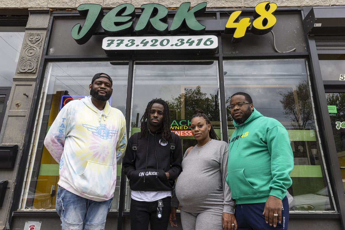 pose for a portrait outside Jerk 48 a restaurant used frequently for Korporate's skits at 548 E. 67th St. in West Woodlawn