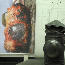The lantern used on the Confederate submarine H.L. Hunley is seen after conservation in a lab in North Charleston, S.C., on Thursday, April 19, 2012. The picture to the left shows what the lantern looked like after the sub, the first in history to sink an enemy warship, was raised off the South Carolina coast 12 years ago.