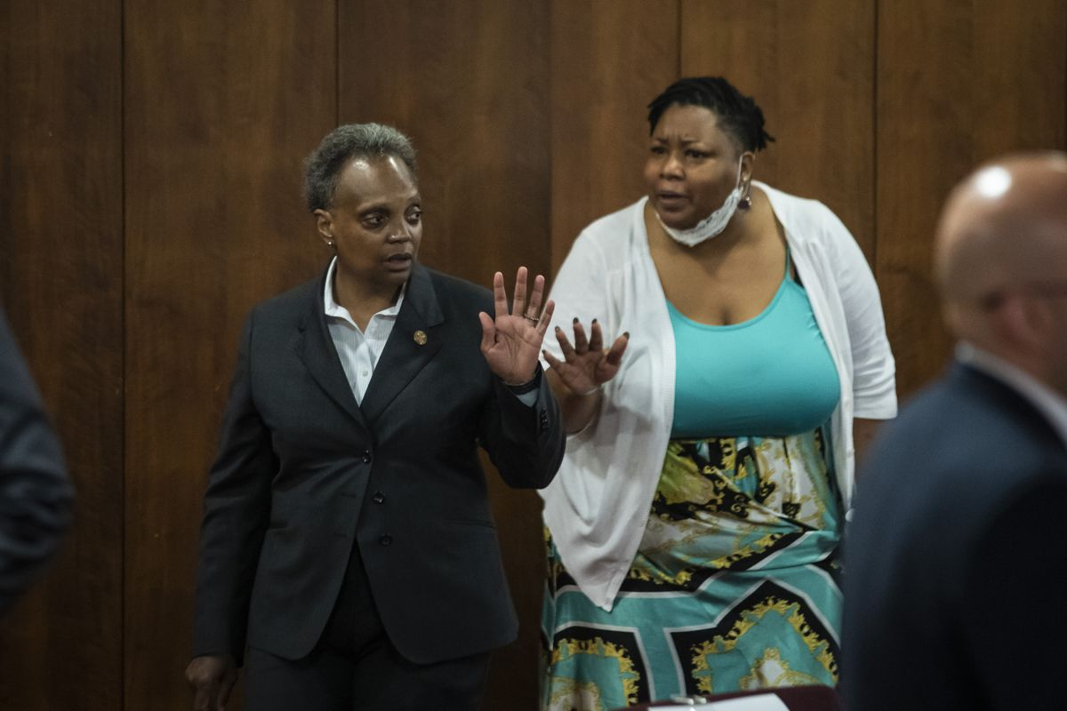 Mayor Lori Lightfoot exchanges heated words with Ald. Jeanette Taylor (20th) during a Chicago City Council meeting at City Hall, Wednesday morning, June 23, 2021.