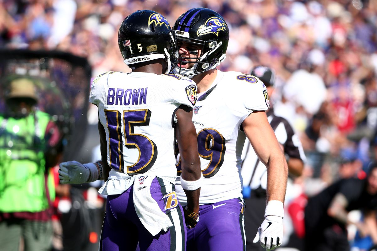 Marquise Brown of the Baltimore Ravens celebrates a catch with teammate Mark Andrews #89 against the Arizona Cardinals during the second half at M&T Bank Stadium on September 15, 2019 in Baltimore, Maryland.