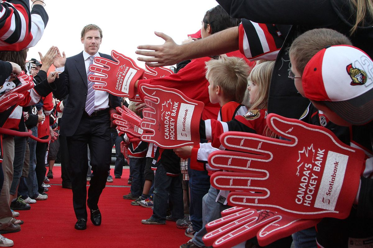 Daniel Alfredsson navigates a gauntlet of foam hands and drooling super-fans.  (Photo by Jana Chytilova/Freestyle Photography/Getty Images)
