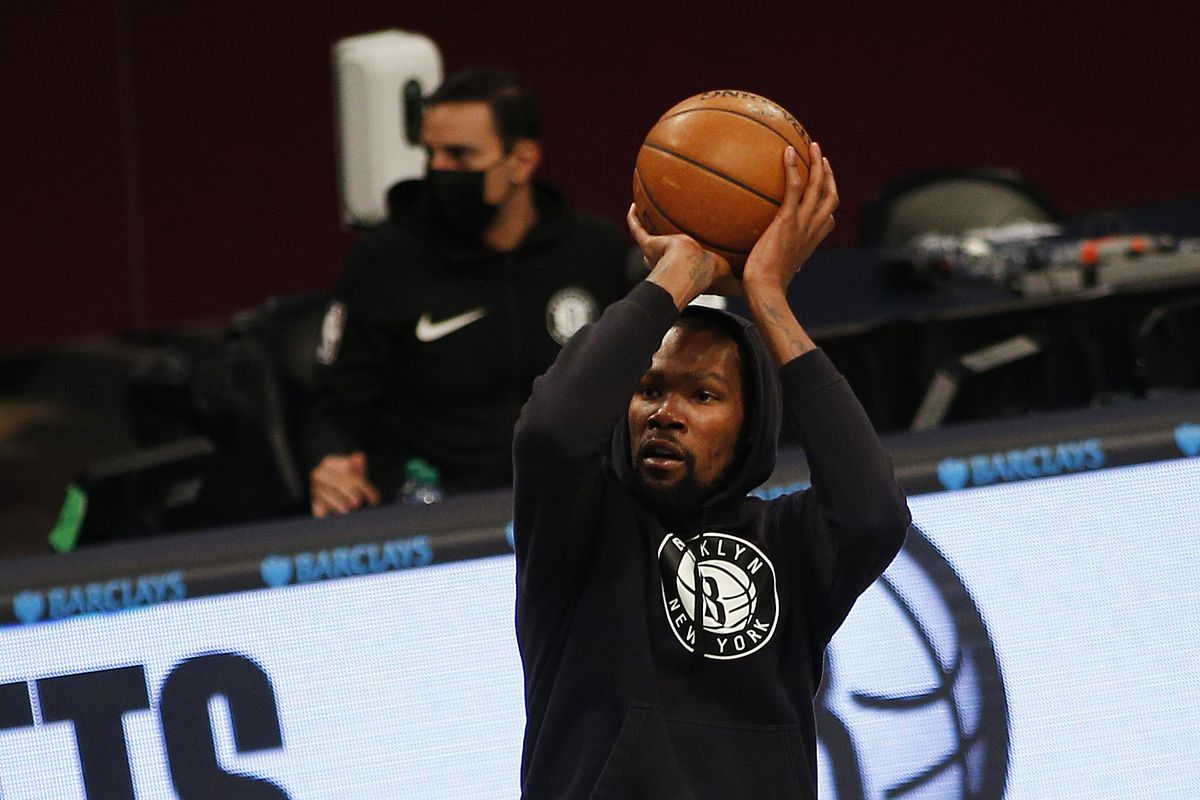 Brooklyn Nets forward Kevin Durant takes a shot during warmups prior to the game against the Charlotte Hornets at Barclays Center.