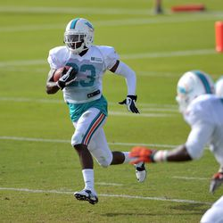 Jul 24, 2013; Davie, FL, USA; Miami Dolphins defensive back De'Andre Presley (23) runs during rick-off returns during training camp practice at the Doctors Hospital Training Facility at Nova Southeastern University.
