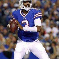 Aug 16, 2013; Orchard Park, NY, USA; Buffalo Bills quarterback E.J. Manuel (3) drops to pass against the Minnesota Vikings during the second half at Ralph Wilson Stadium. Bills beat the Vikings 20-16.