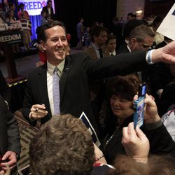 FILE - In this April 3, 2012 file photo, Republican presidential candidate, former Pennsylvania Sen. Rick Santorum greets supporters in Cranberry, Pa.  Republican presidential candidate Rick Santorum's plan to use state conventions to pull support from Mitt Romney has stalled in North Dakota, where Romney has the largest group of backers among the state's national convention delegates.
